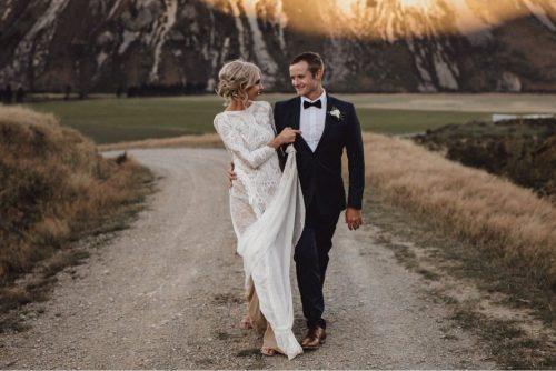 Wedding reception in red barn at flock hill station, new zealand photographed by sunshine coast wedding photographer
